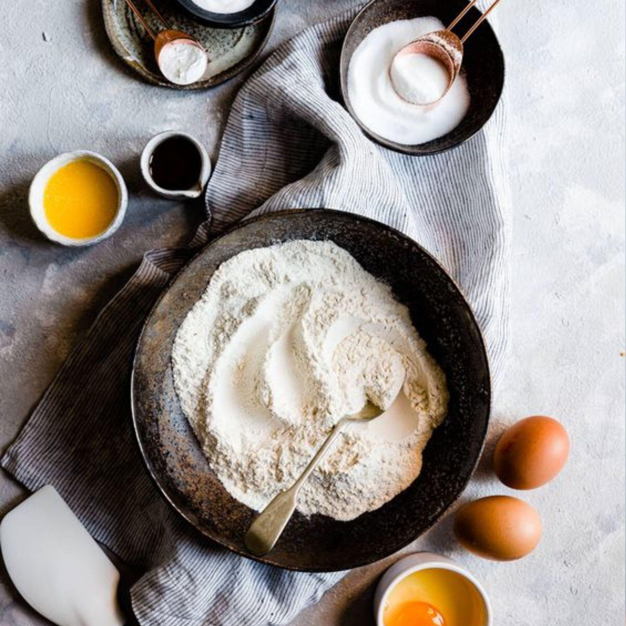 Baking essentials (flour, egg, sugar) flatlay