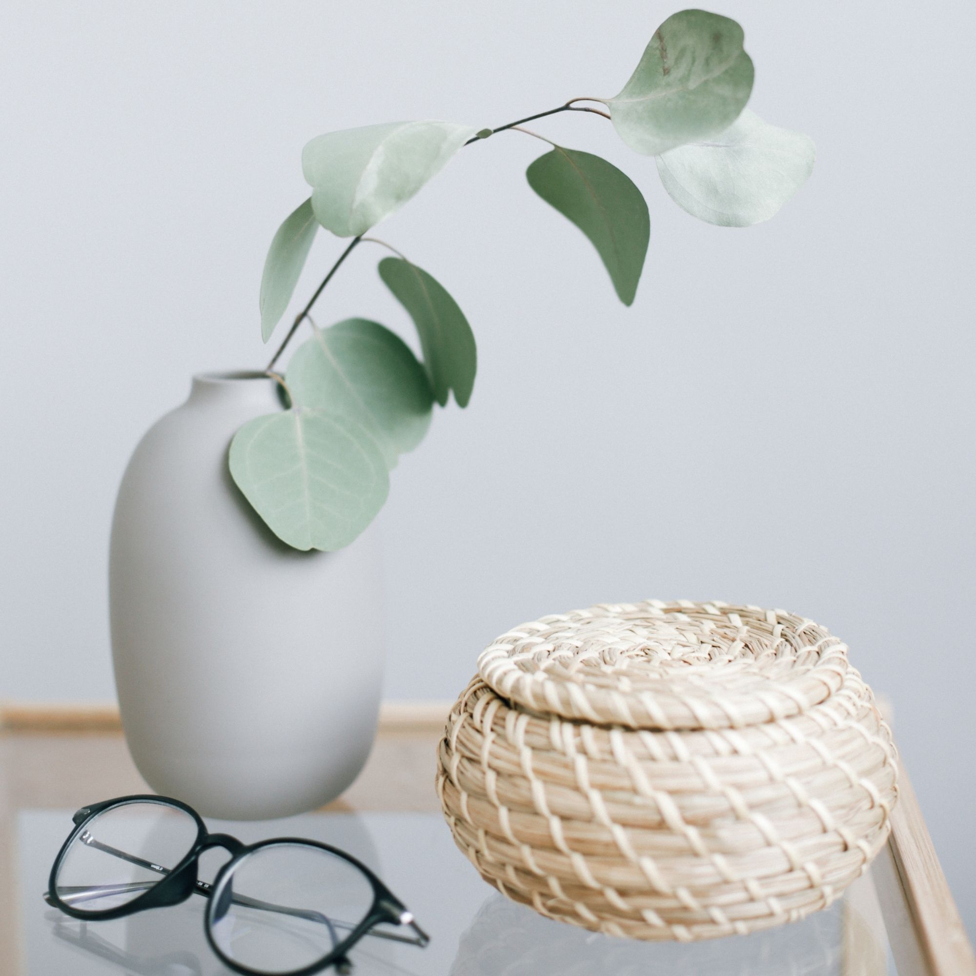 Glasses on table with brown wicker table and vase
