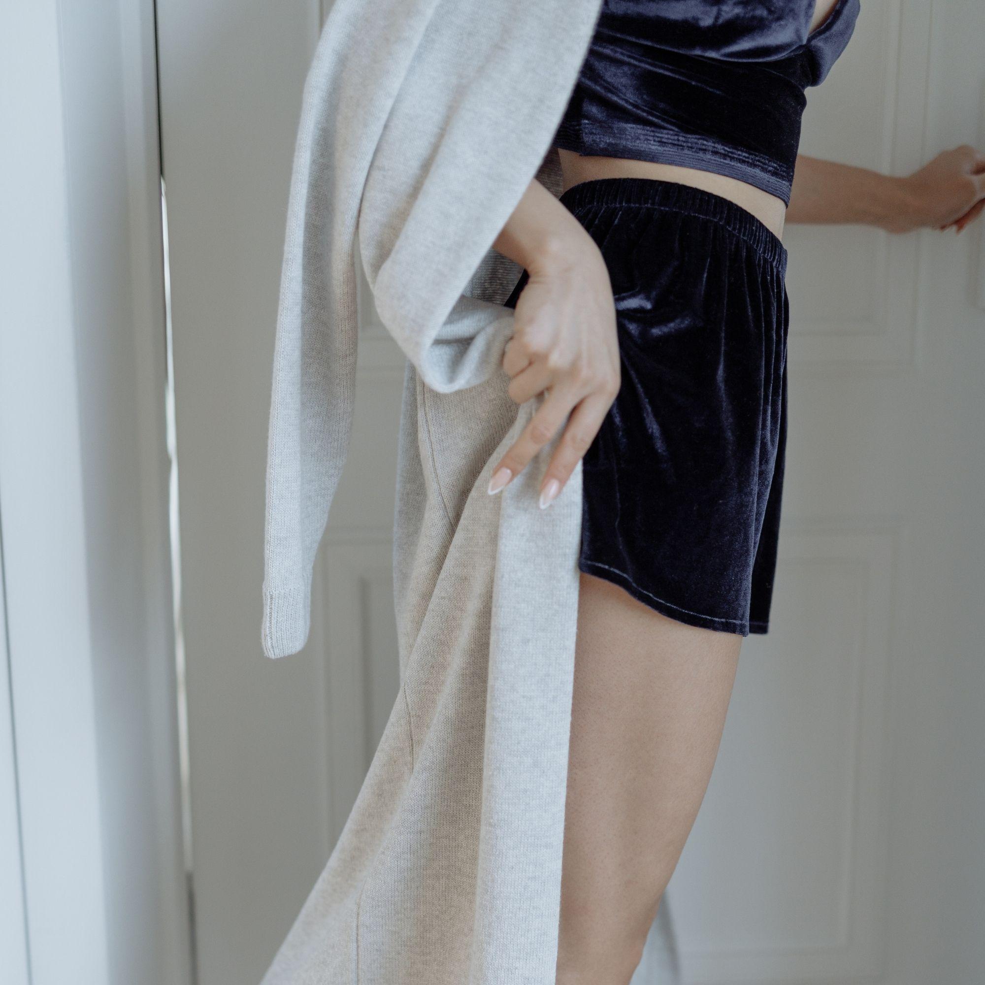 Woman in cozy beige throw cardigan