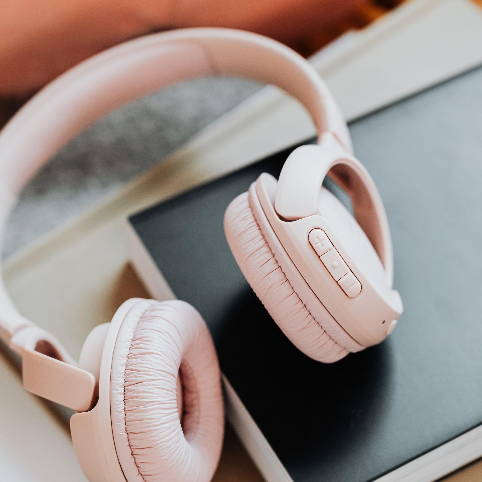 Pink headphones on notebook