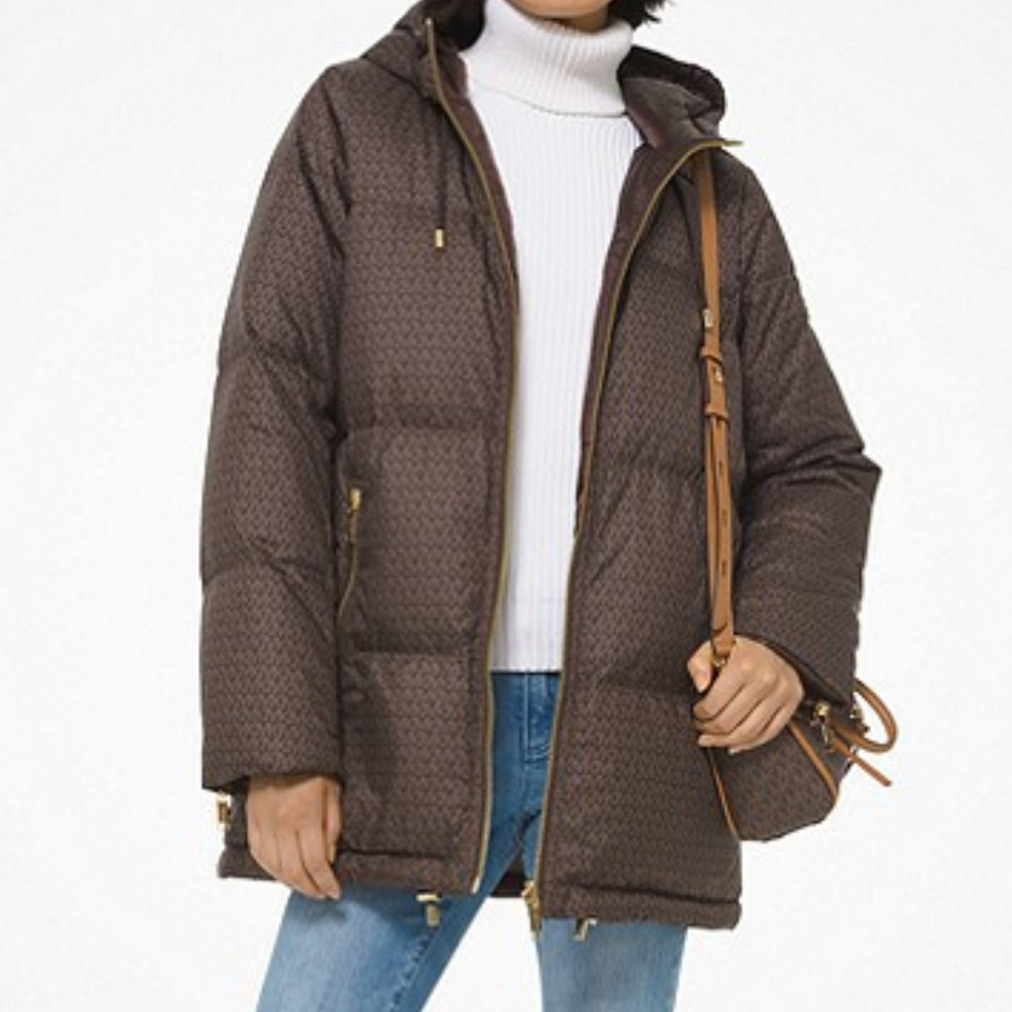 Brown puffer coat with handbag over shoulder