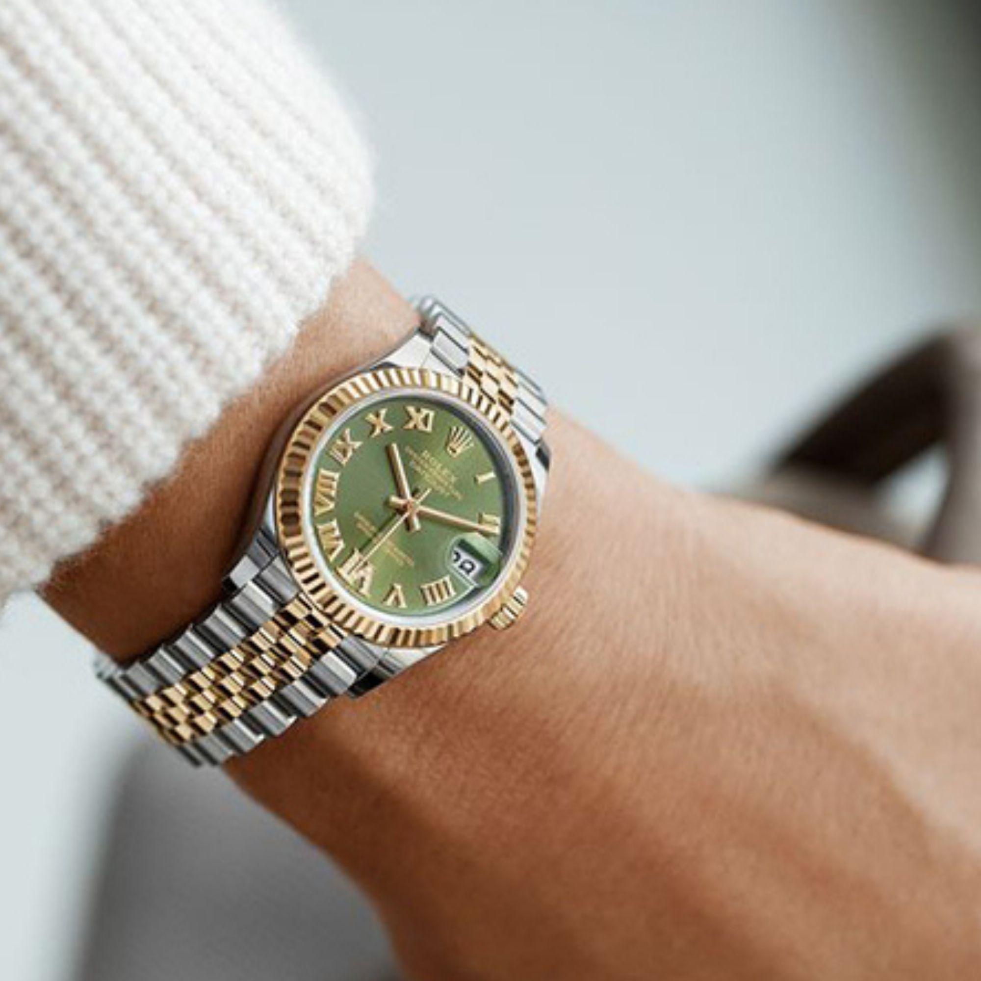 Rolex watch with light green face
