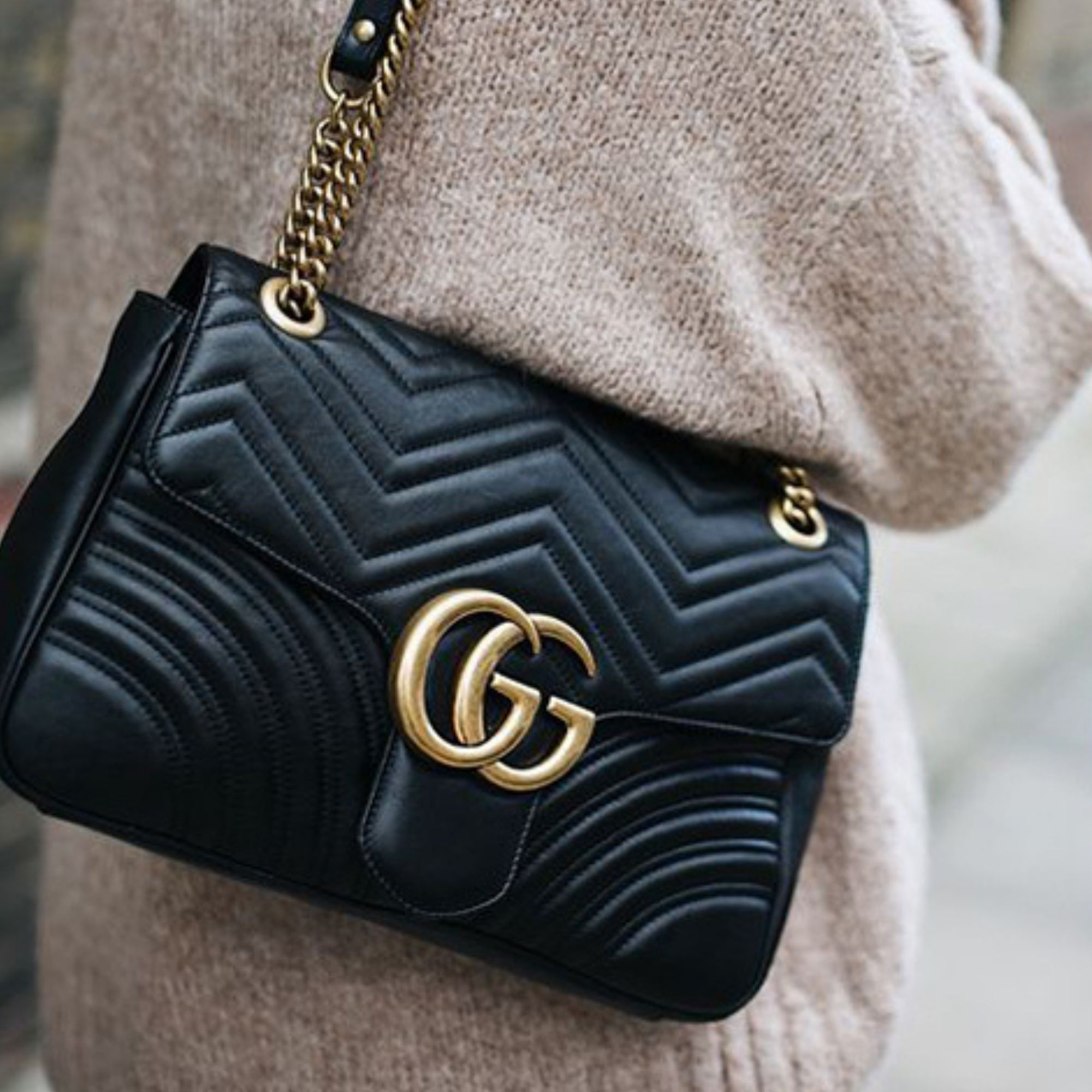 Black Gucci bag with gold hardware