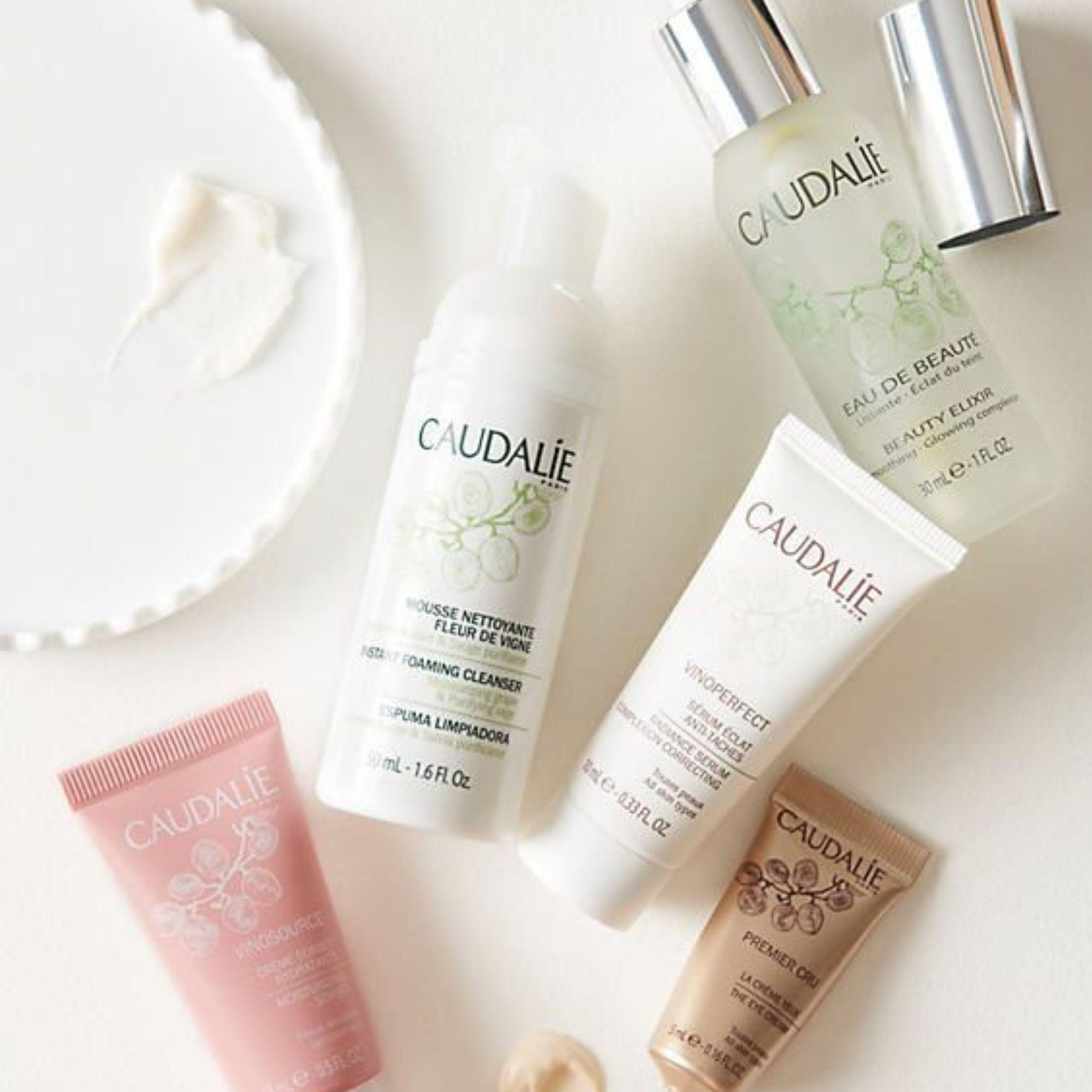 Caudalie skincare products flatlay