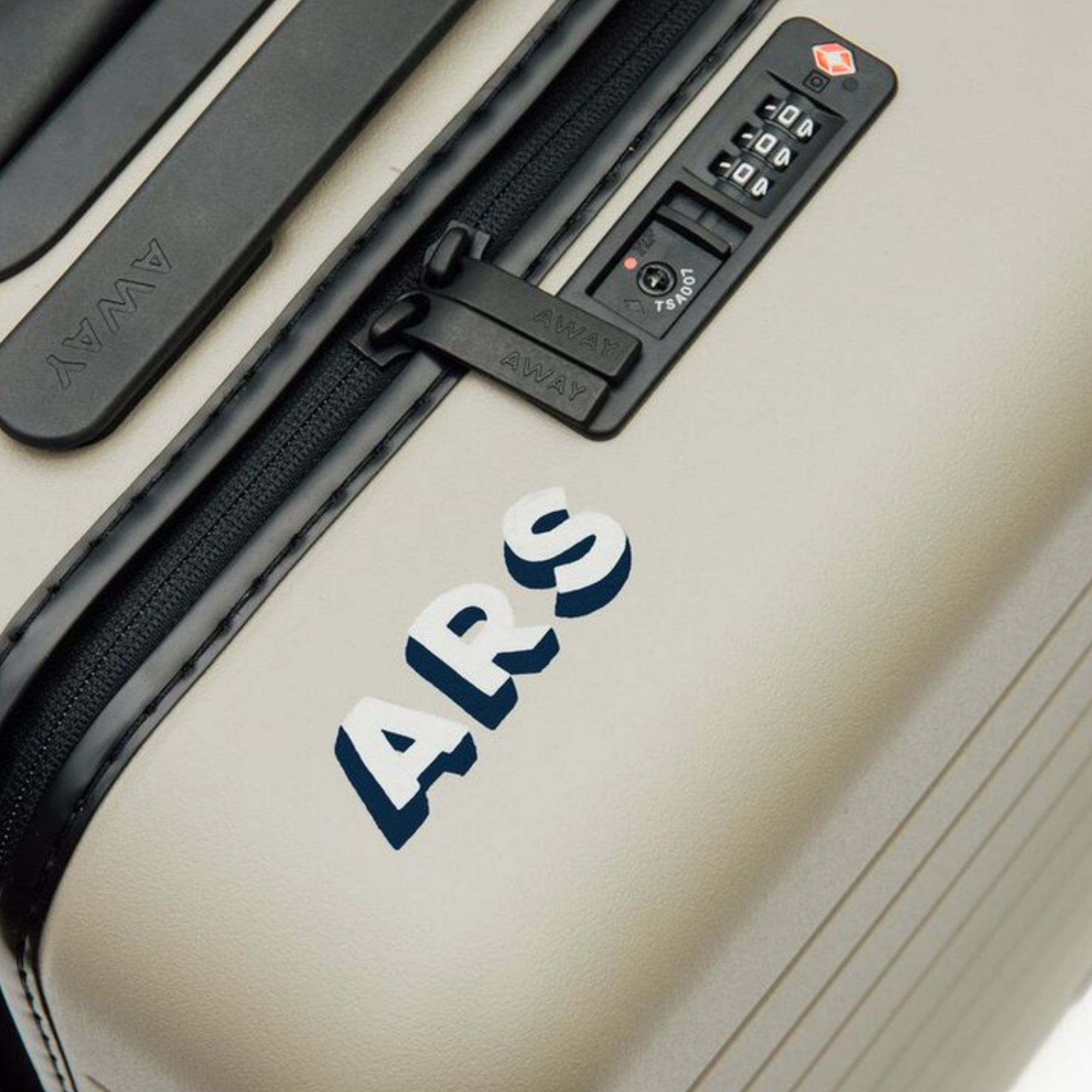 Customized lettering on Away luggage