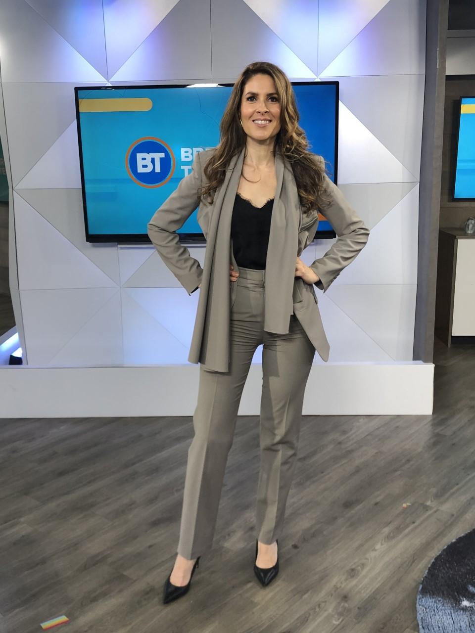 Dina wearing a grey blazer and matching suit pants - 2