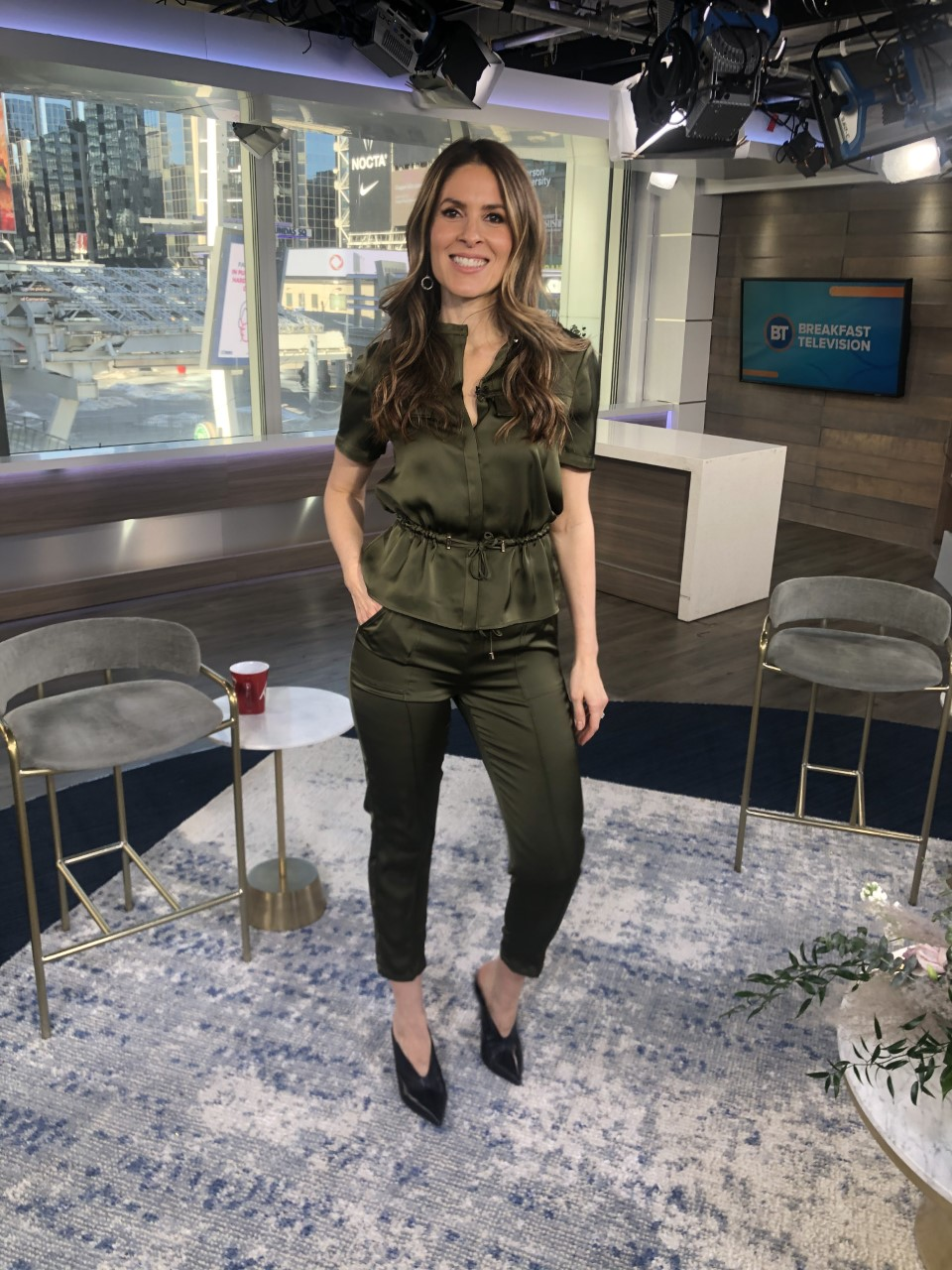 Dina wearing army green silk top with bottoms