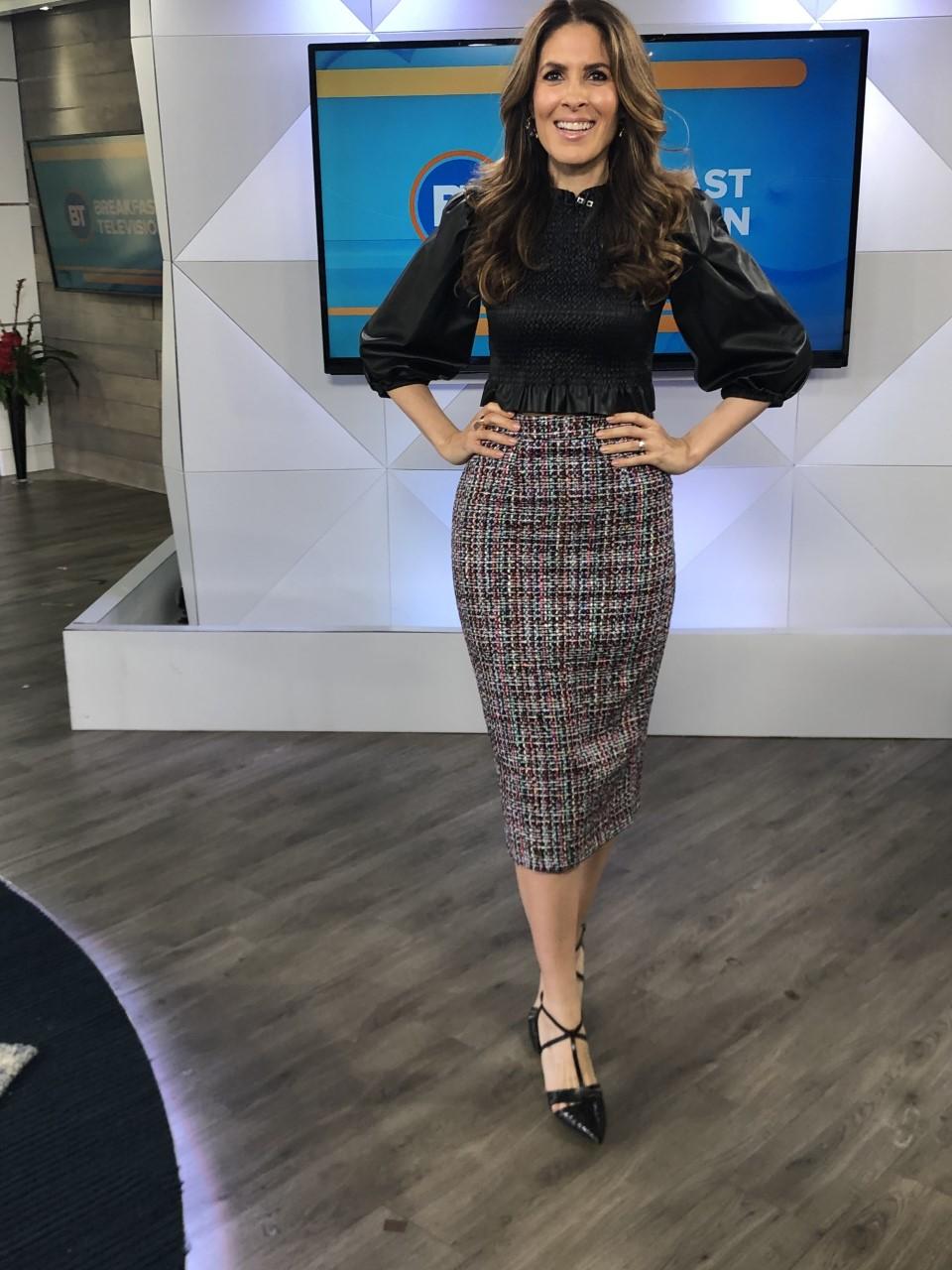 Dina wearing tweed printed skirt with black top