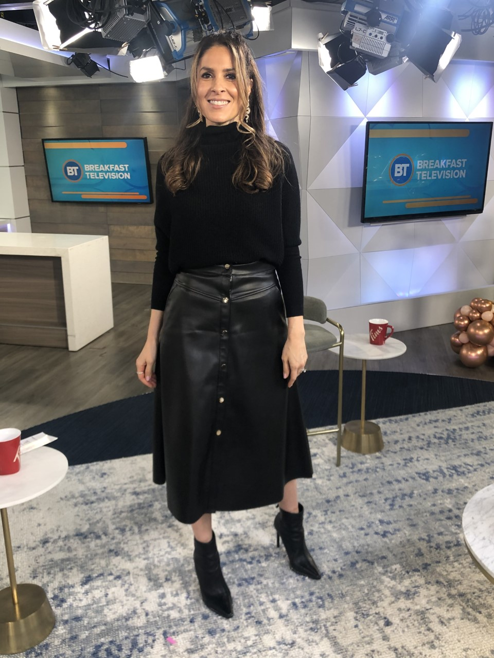 Dina wearing black leather skirt with black long sleeve