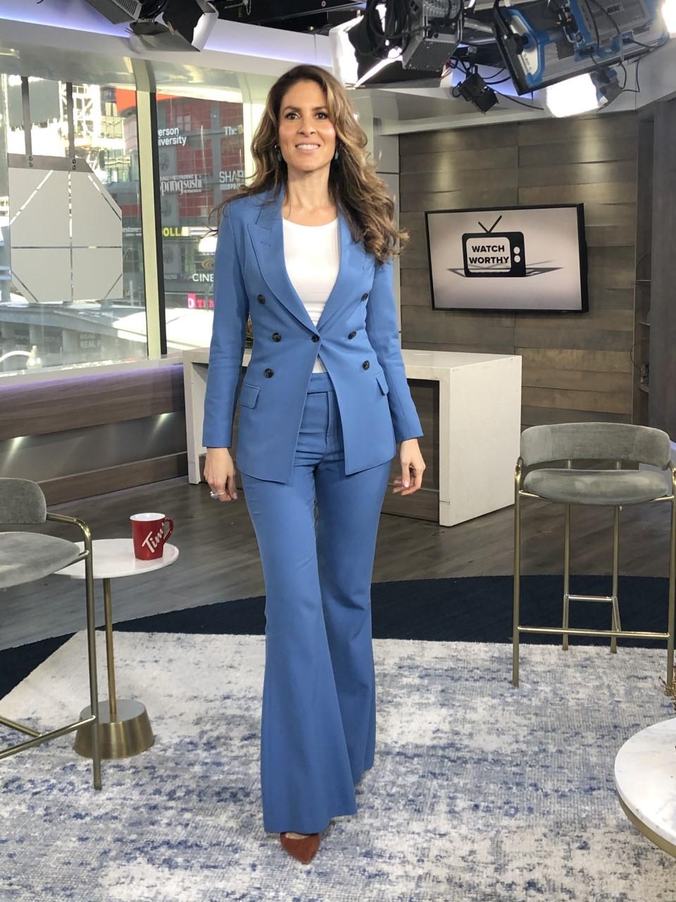 Dina wearing blue blazer and pants ensemble - 2