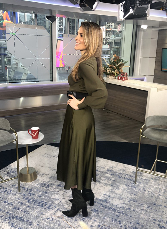 Dina wearing dark army green skirt with black pointy boots