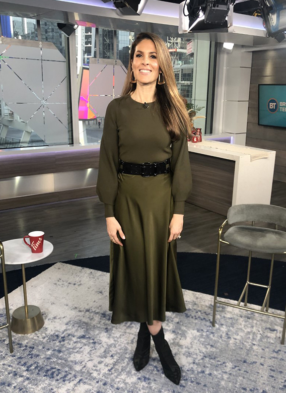 Dina wearing dark army green skirt with black pointy boots - 2