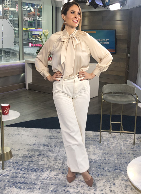 Dina wearing beige satin blouse with white wide leg pants - 2