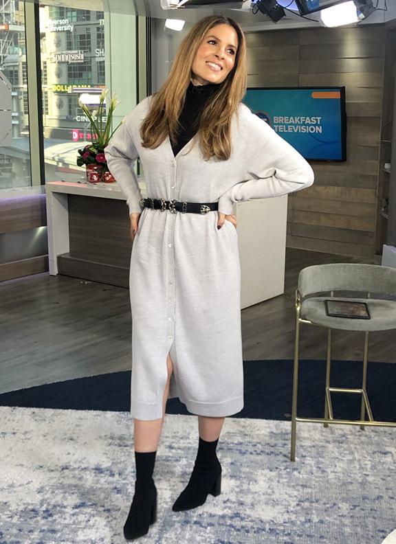 Dina wearing black turtleneck underneath white long cardigan with black booties - 2