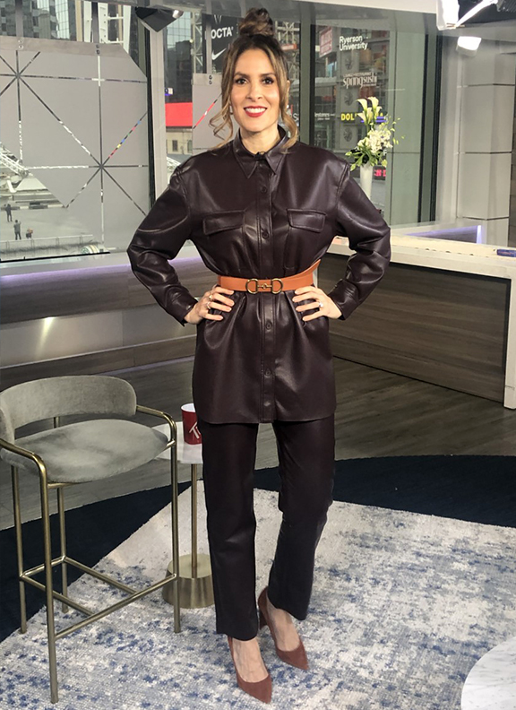 Dina wearing dark brown leather belted top with pants