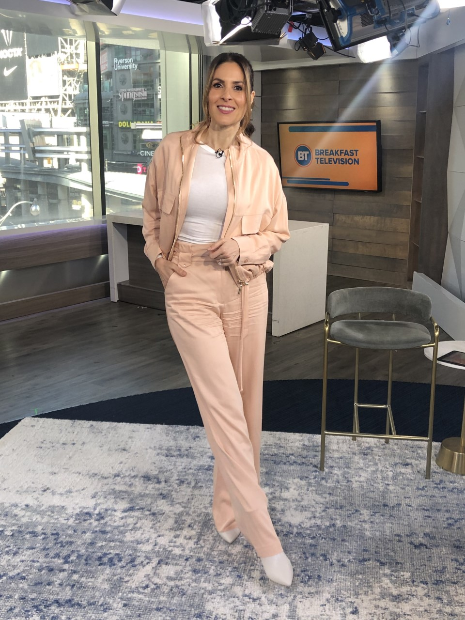Dina wearing all pink ensemble with white top