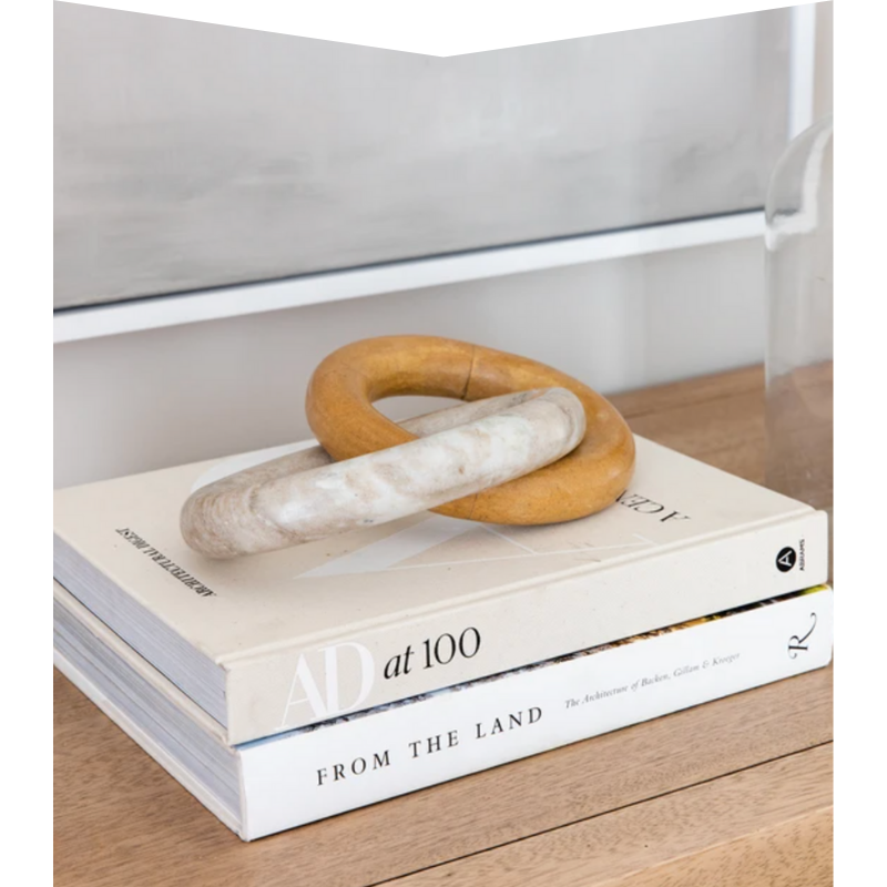 Two stacked coffee table books