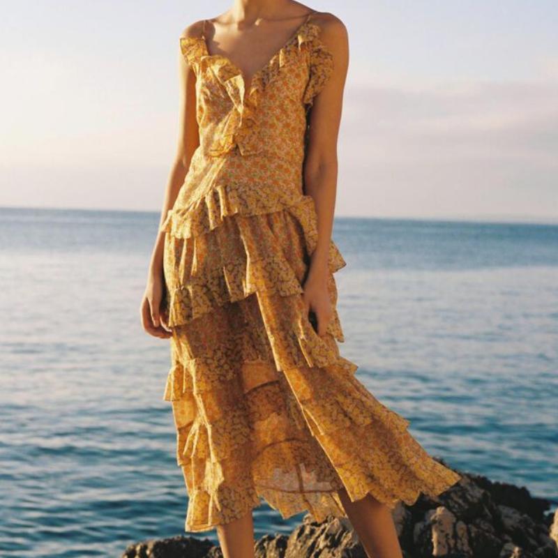Yellow ruffle dress from Maje